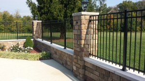 retaining wall with iron fence
