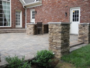 brick patio with brick pillars