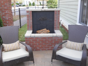 Outdoor red brick fireplace