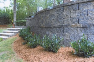 brick retaining wall with landscaping