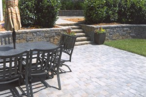 brick retaining wall with patio