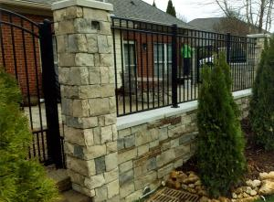 Stone wall with metal fencing