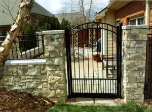 Stone wall with metal gate
